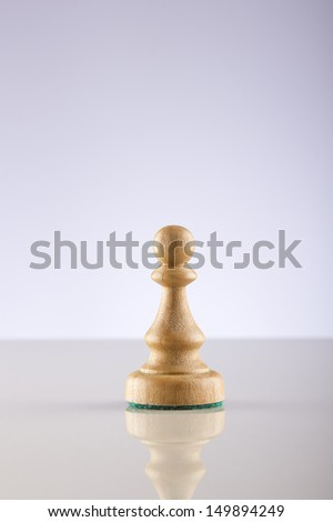 Chess pawn on light background - stock photo
