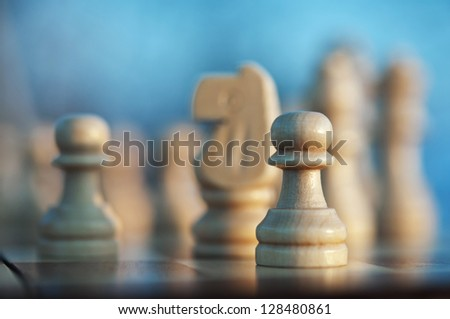 chess pawn piece on board - stock photo