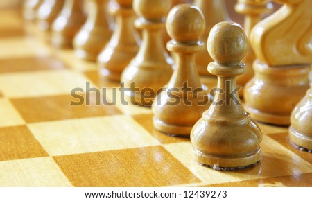 Chess pawns in a row - stock photo