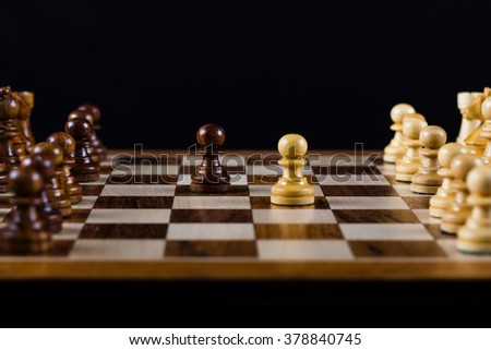 Chess pawns on chess board - stock photo