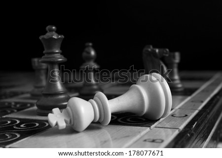 Chess photographed with dark background - stock photo