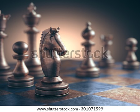 Chess piece in focus on the board. - stock photo