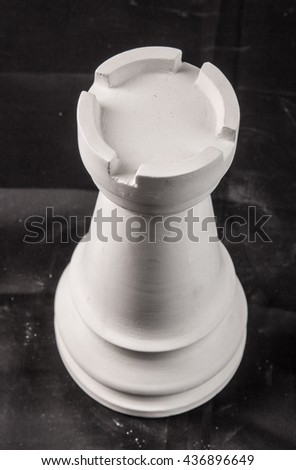 chess piece white plaster on a black background