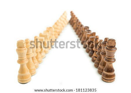 Chess pieces aligned in two colors, isolated on white background - stock photo