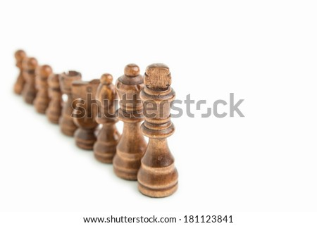Chess pieces aligned, isolated on white background