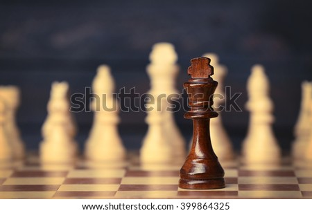 Chess pieces and game board closeup - stock photo