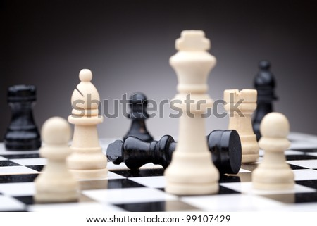 Chess pieces. Focused on black king - stock photo
