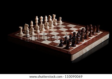 chess pieces isolated on a black background - stock photo