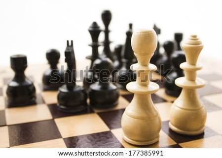 Chess pieces on a board in different compositions.