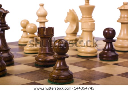 Chess pieces on a chessboard - stock photo