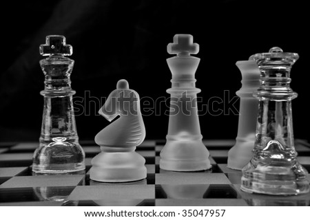 Chess Pieces on a glass chessboard