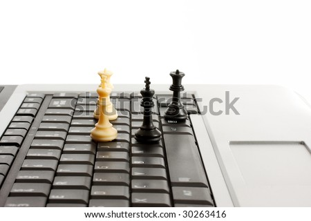chess pieces on a laptop or notebook computer depicting online gaming - stock photo