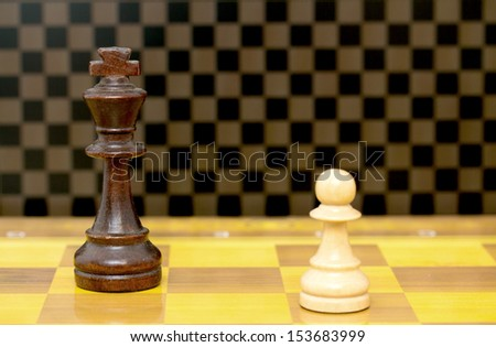 chess pieces on a wooden board - stock photo