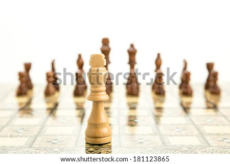 Chess pieces on board, isolated on white background - stock photo