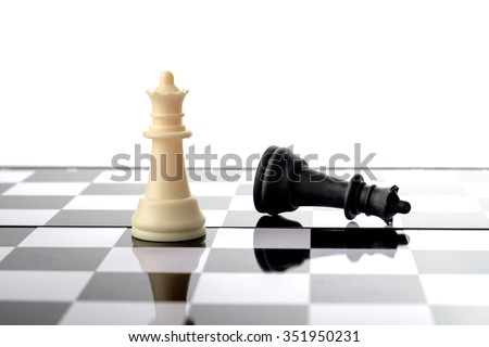 Chess pieces, queen and fallen king. Strategy and competition conceptual. - stock photo