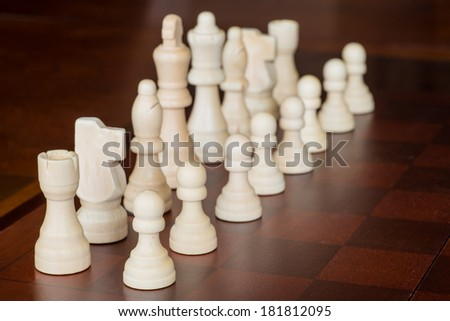 Chess pieces set up on board