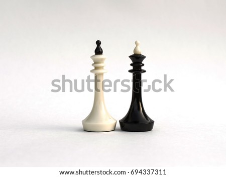 Chess pieces. White and black king as heads of state on a white