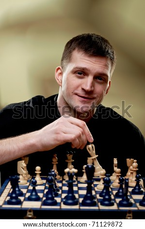 Chess player at a chess board - stock photo