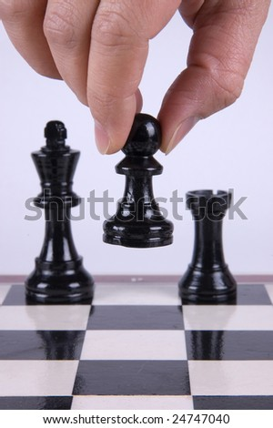 Chess player making his move. - stock photo