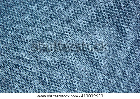 Chess texture fluffy cloth. Dark blue background. Fabric background. - stock photo