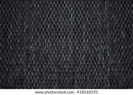 Chess texture fluffy cloth. Dark grey background. Fabric background. - stock photo
