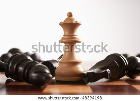 Chess the queen wins victory over the game selective foucs - stock photo