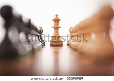 chess two rows of pawns with white king center selective focus - stock photo