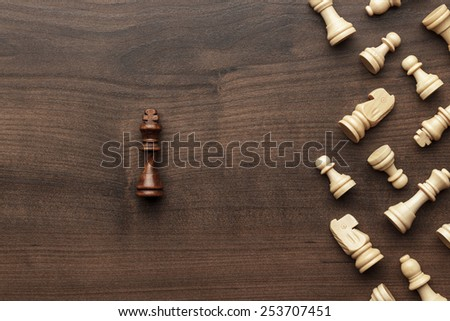 chess uniqueness concept on the wooden background - stock photo