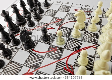 Chess. White board with chess figures on it. Plan of battle. - stock photo