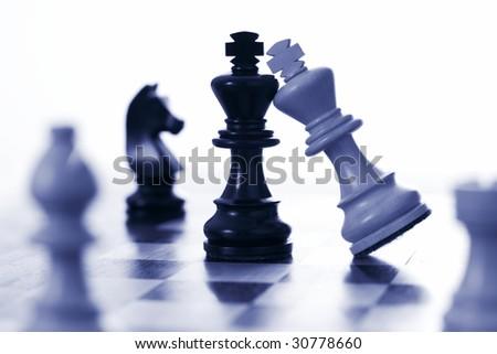 Chess white king attacks black king blue tone - stock photo