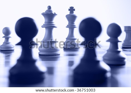 chess white queen on the attack blue toned - stock photo