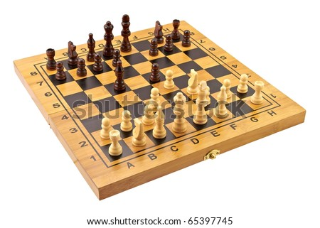 Chessboard with figures in progress - stock photo