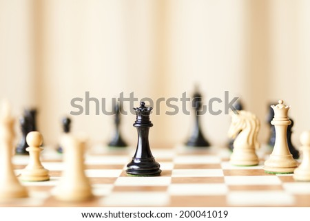 chessboard with luxury chess pieces  - stock photo
