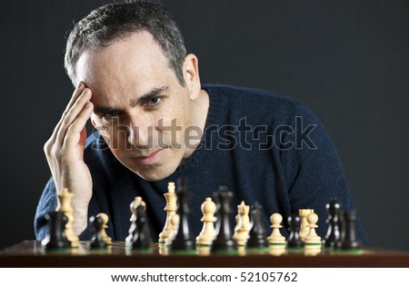 Chessboard with man thinking about chess strategy