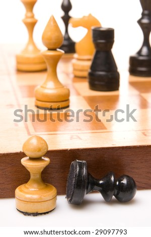 Chessmen on a chessboard, white background