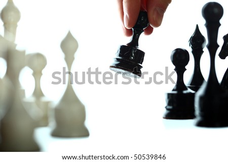 chessplayer making a move on white background.