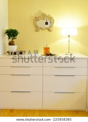 Chest drawer in the interior of a stylish bedroom
