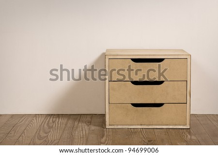 Chest drawer in the interior of an old room. - stock photo