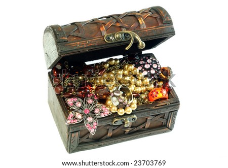 Chest full of jewelry, isolated on a white background - stock photo