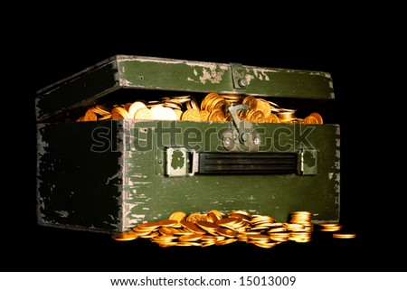 chest full of money; treasure chest with gold coins - stock photo