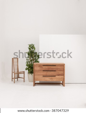 chest of drawers interior decor with wood chair - stock photo