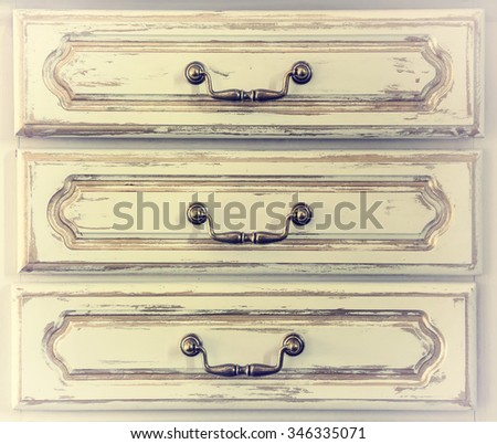 chest of drawers, wooden chest of drawers old metal fittings, detail, vintage, retro, old photo - stock photo