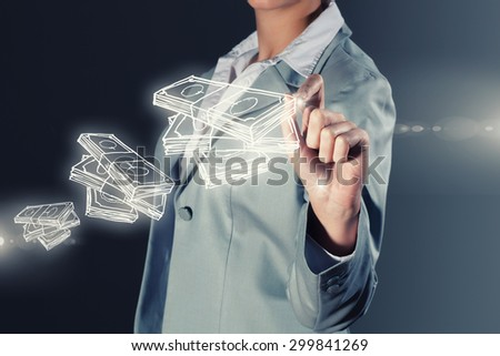 Chest view of businesswoman drawing money banknotes on screen