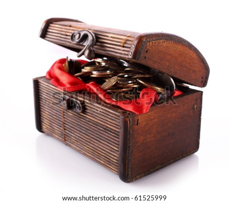 Chest with coins isolated on white - stock photo