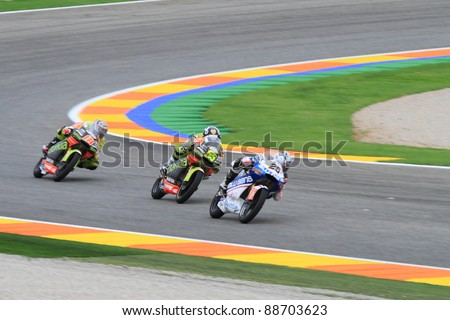 CHESTE - NOVEMBER 6: Maverick Viñales (25), hector faubel (55) and Nico Terol (18) participating at final race of MotoGP Grand Prix 2011 on November 6, 2011 in Cheste (Valencia), Spain