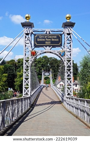 CHESTER, UNITED KINGDOM - JULY 22, 2014 - View across the River Dee Suspension Bridge aka Queens Park Suspension bridge, Chester, Cheshire, England, UK, Western Europe, July 22, 2014. - stock photo