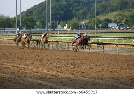 CHESTER, WEST VIRGINIA - JUNE 14: Race horses head down the stretch at The Mountaineer Racetrack on June 14, 2010 in Chester West Virginia.