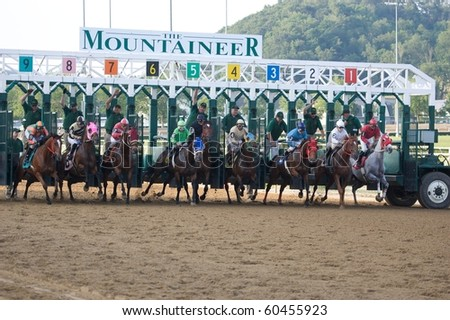 CHESTER, WEST VIRGINIA - JUNE 14: Race horses leave the shoot at The Mountaineer Racetrack on June 14, 2010 in Chester West Virginia. - stock photo