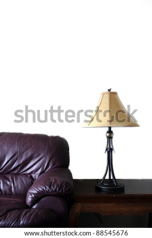 Chesterfield couch leather and lamp in new home interior - stock photo
