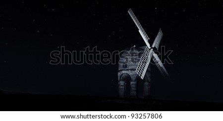 Chesterton Windmill, spotlit with a starry background. - stock photo